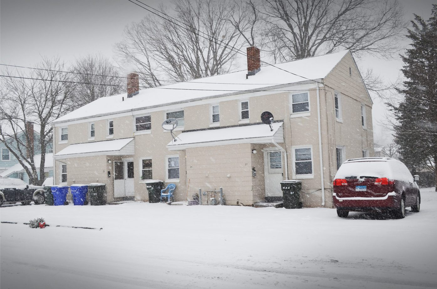 Connecticut rental property with snow on walkway and driveway